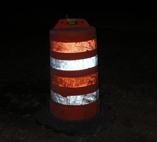 orange highway barrel at night